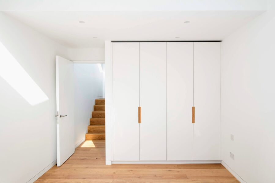 Wardrobe with PU lacquered fronts and oak inlay handles.