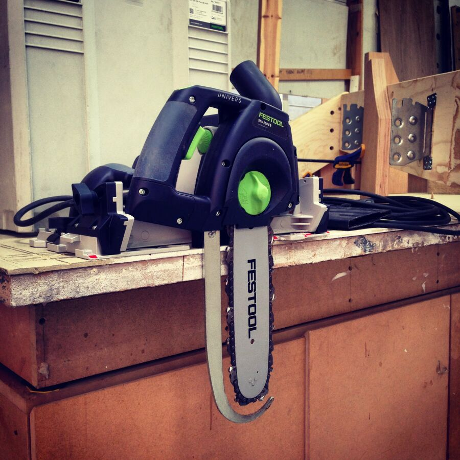 A Festool rail chainsaw for preparing the Kerto angled joist cuts in the workshop.