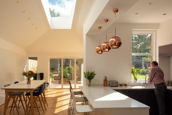Modern kitchen and dining room flooded with natural light.