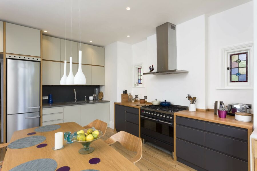 Modern kitchen with a mixture laminated plywood & sprayed fronts and concrete & solid oak worktops.
