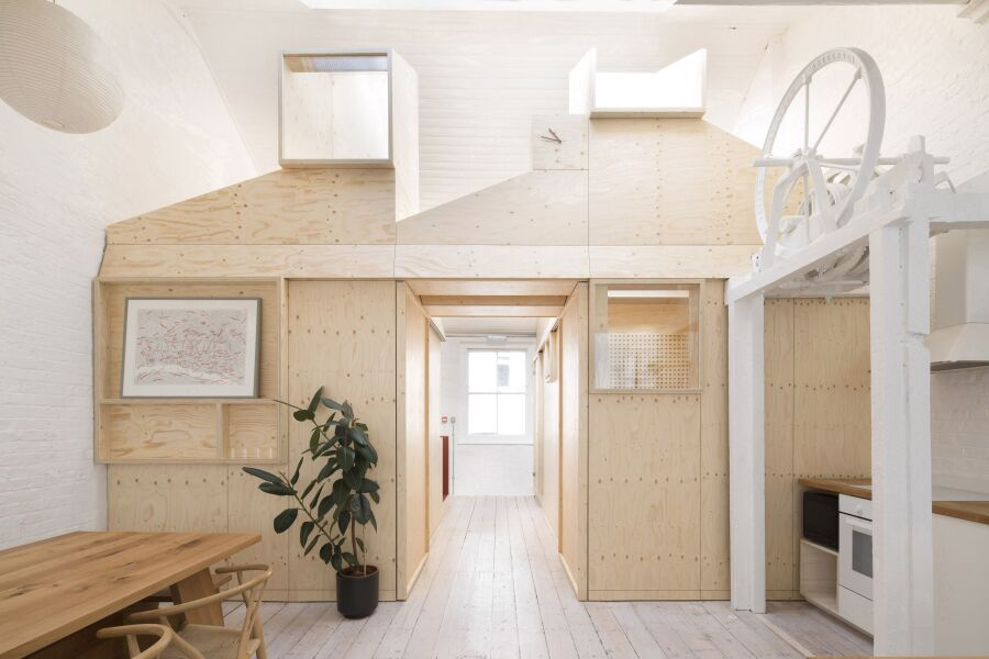 Spruce plywood office structure in a Victorian warehouse.
