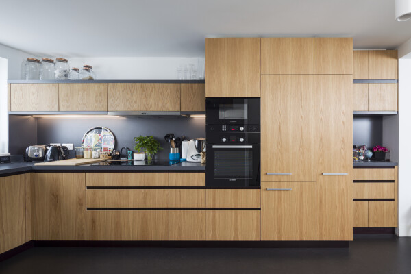 Kitchen with Oak veneered birch plywood fronts, Formica Colourcore worktops.