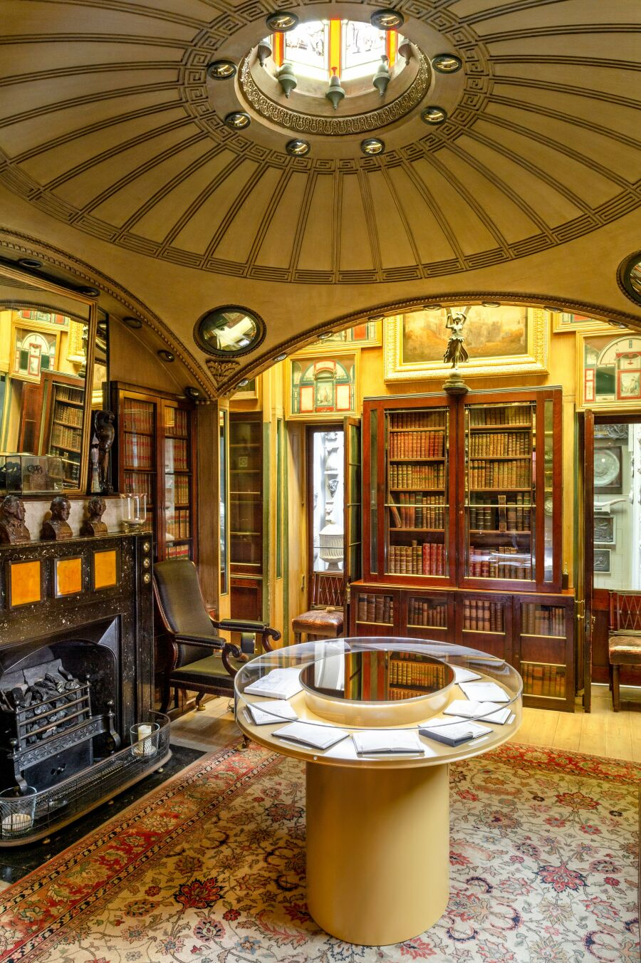 Library room with a circular perspex display cabinet.