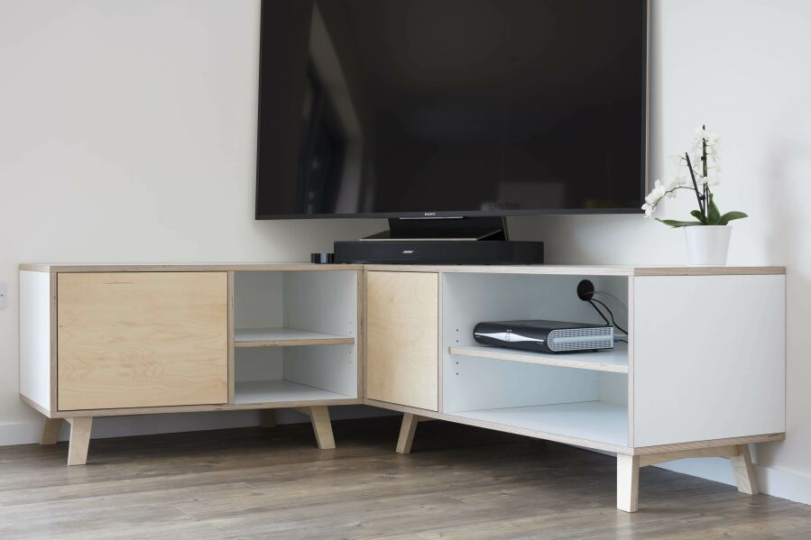 Modern corner audio and video unit made from laminated birch plywood.