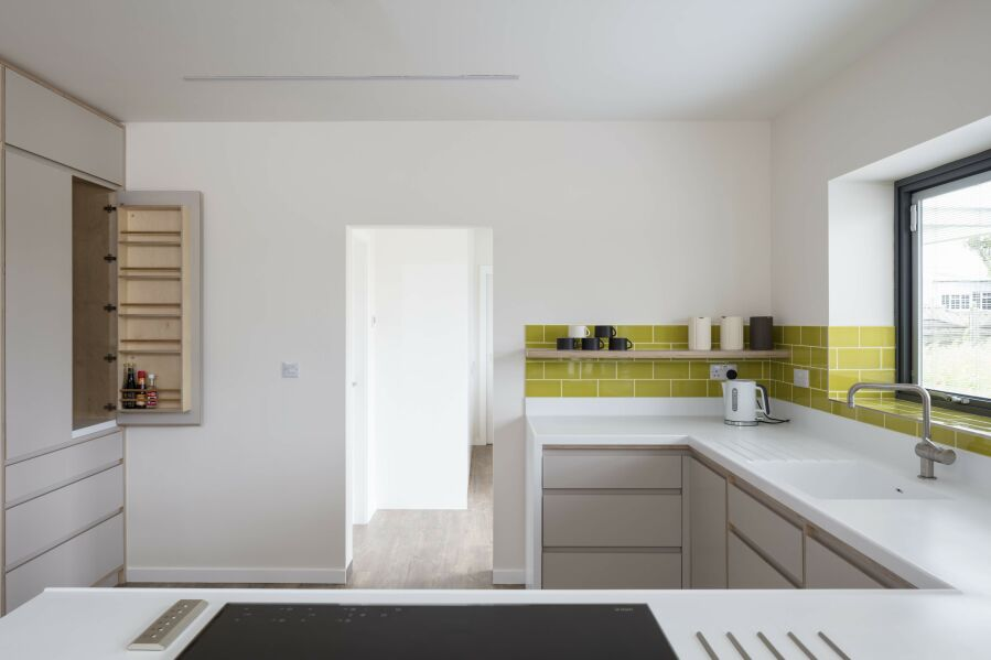 Modern kitchen with laminated birch plywood fronts and Corian worktops.