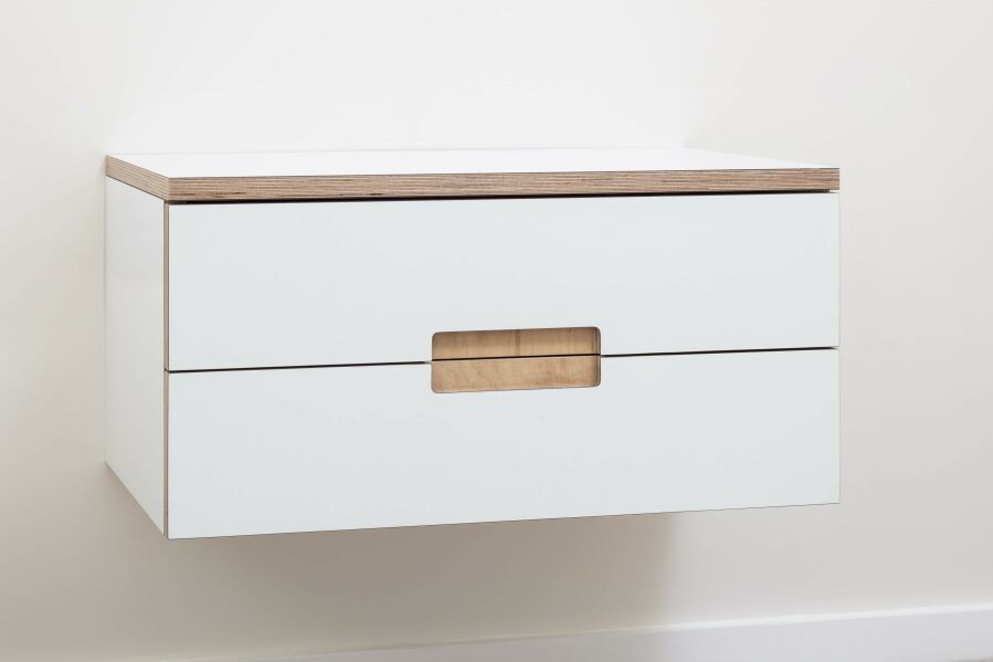Laminated birch plywood floating bedside table with routed finger pull handle detail.