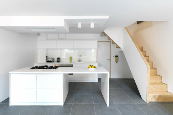 ​Modern kitchen, solid maple winding stair case.