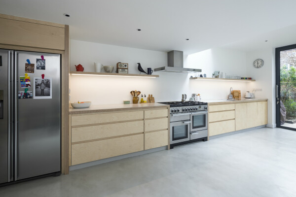 Modern plywood kitchen with a polished concrete floor